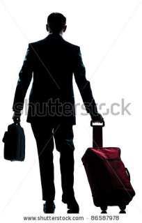 stock photo  rear view one caucasian business traveler man walking